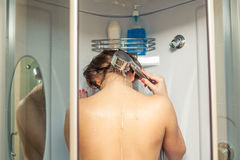 Blonde in shower from back Royalty Free Stock Photo