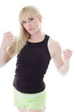 Blonde showing fists Royalty Free Stock Photos
