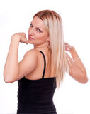 Blonde showing muscle Royalty Free Stock Photo