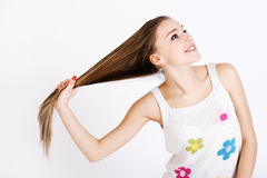 Blonde shows off his long hair Stock Image