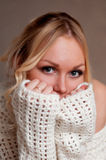 Blonde shyly covers her face with her hands. Royalty Free Stock Photo