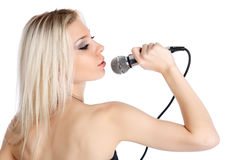 Blonde singer Stock Images