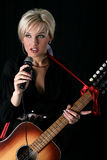 Blonde singer. A blonde singer with mic Royalty Free Stock Photo
