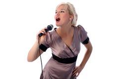 Blonde singer. Lovely blondie girl singer isolated on white Stock Photo