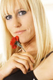 Blonde with single flower Stock Photo