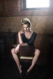 blonde sitting on a chair Royalty Free Stock Image