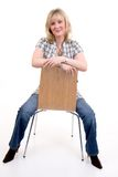 Blonde Sitting On Chair royalty free stock photography