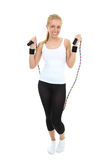 Blonde with skipping rope standing Royalty Free Stock Image
