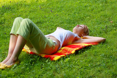 Blonde sleeping in meadow Royalty Free Stock Image