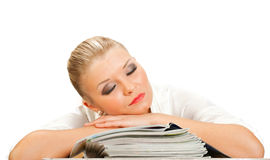 Blonde sleeps on a pack of glossy magazine Stock Photo
