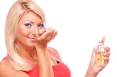 Blonde smelling perfumed hand Royalty Free Stock Image