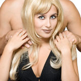 Blonde smile girl and mans hands Stock Images