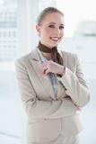 Blonde smiling businesswoman looking at camera Royalty Free Stock Photo