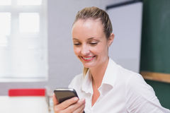 Blonde smiling businesswoman using smartphone Royalty Free Stock Image