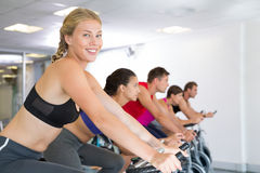 Blonde smiling at camera during spin class Royalty Free Stock Photos