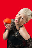 Blonde smiling and holding tomato Royalty Free Stock Images
