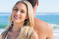Blonde smiling and leaning against her boyfriend Royalty Free Stock Images
