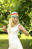 Blonde smiling sporty girl working out outdoor. Stock Photo