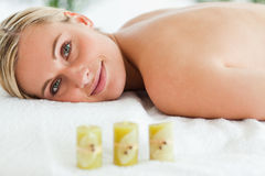 Blonde smiling woman lying on massage lounger Stock Photo