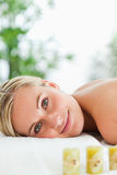 Blonde smiling woman relaxing on massage lounger Stock Image