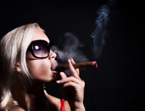 Blonde smoking a cigarette Stock Images