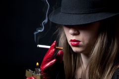 Blonde smoking cigarette young fashion girl Royalty Free Stock Image