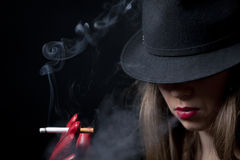 Blonde smoking cigarette young fashion girl Royalty Free Stock Photos