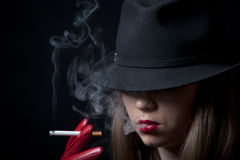 Blonde smoking cigarette young fashion girl Royalty Free Stock Photo