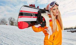 Blonde snowboarder on snow Royalty Free Stock Image