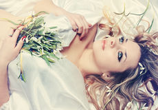 Blonde with snowdrops, tinted Royalty Free Stock Photos