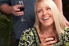 Blonde Socializing with Wine Glass Stock Photo