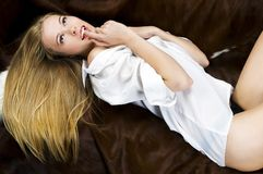 Blonde on the sofa. Portrait of the beautiful blonde. She is lying on the sofa Stock Photo