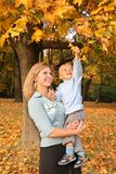 Blonde with the son in park Royalty Free Stock Image