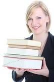Blonde sorridente amichevole con un mazzo di libri Fotografie Stock Libere da Diritti