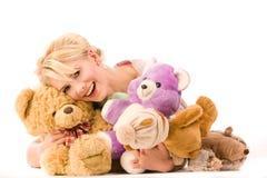 Blonde sorridente infantile Immagini Stock