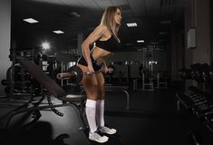 Woman working out with barbell Stock Image