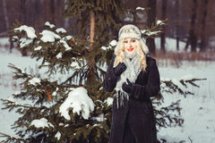 Blonde standing by the tree Royalty Free Stock Photos