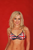 Blonde standing in union jack bra Stock Photos