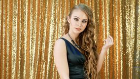 The blonde starts to dance gold glitter background stock footage