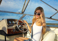Blonde at steering wheel Stock Photography