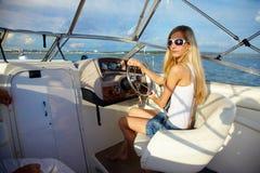 Blonde at steering wheel Stock Photo