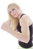 Blonde in strijdpositie Stock Foto's