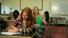 Blonde student asking her lecturer a question in class stock video footage