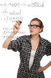 Blonde student girl drawing a mathematical formula. In the air, isolated on white Stock Photography
