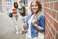 Blonde student with her friends Royalty Free Stock Photo