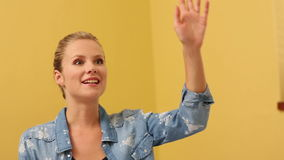 Blonde student raising her hand in classroom Stock Image