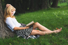 Blonde student reading book Royalty Free Stock Image