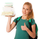 Blonde student with stack of books and backpack, happy to get kn Stock Photo
