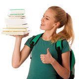 Blonde student with stack of books and backpack, happy to get kn Royalty Free Stock Photos