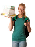 Blonde student with stack of books and backpack, happy to get kn Stock Image
